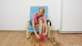 Gorgeous Kasia stuffs her twat in addition to red hose
