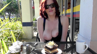 Audrey Grace eating a piece of cake and flashing her natural boobs