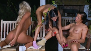 Three lesbian teens with toys