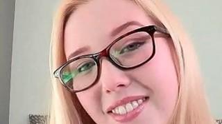 Blonde in glasses masturbates slick pussy