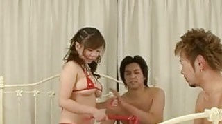 Beautiful J idol blows 2 shafts at once in naughty threesome