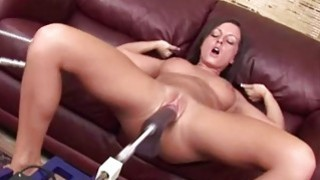 Busty brunette plays with fucking machine