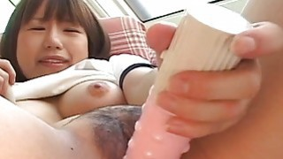 Cute Asian teen with a cute face toy fucks her pus