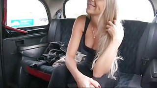 Sexy blonde passenger fucked in the cab to off her fare