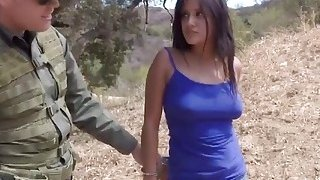 Latina gives head to horny border guard outdoors