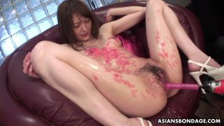 Candle dripped Asian slut sucking on cocks and she