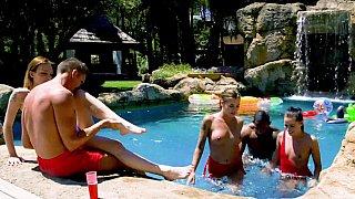 Interracial poolside orgy