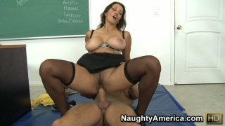 Big tits and hairy pussy are jumping up and down on a cock on a floor